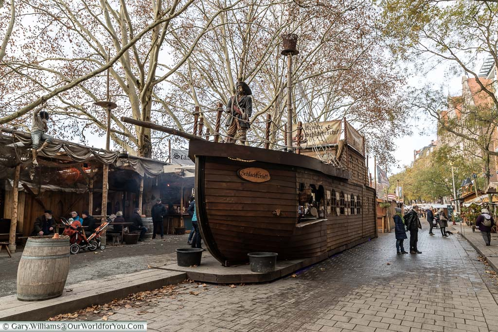 A wooden pirate ship in the centre of the Schlachtezauber market on the quayside in Bremen that is actually a food stall