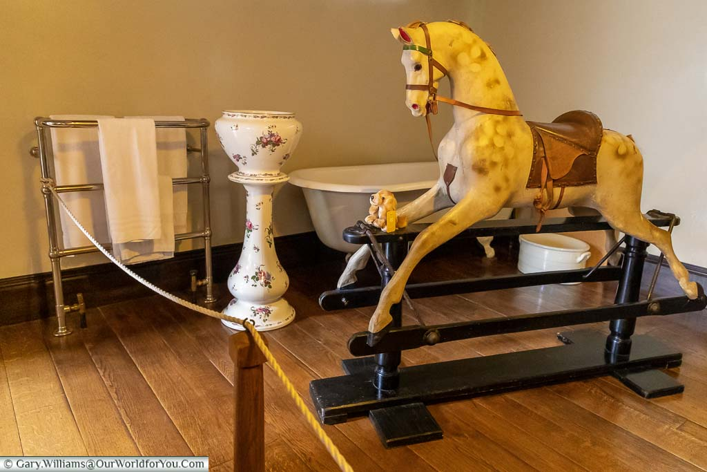 A child's wooden Rocking Horse in the Victorian bathroom in Ightham Mote