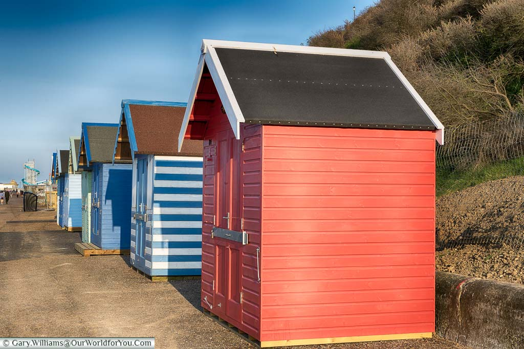 Brightly coloured beach huts line the shoreline at Cromer, on the North Norfolk coastline