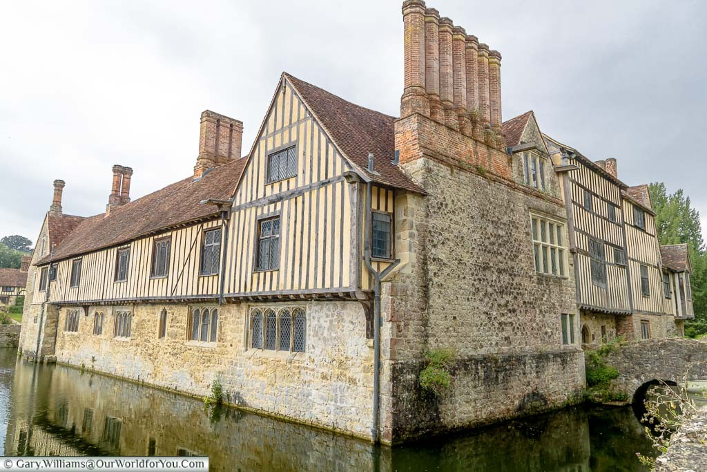 The far corner of view of Ightham Mote overlooking the moat that surrounds the country manor house