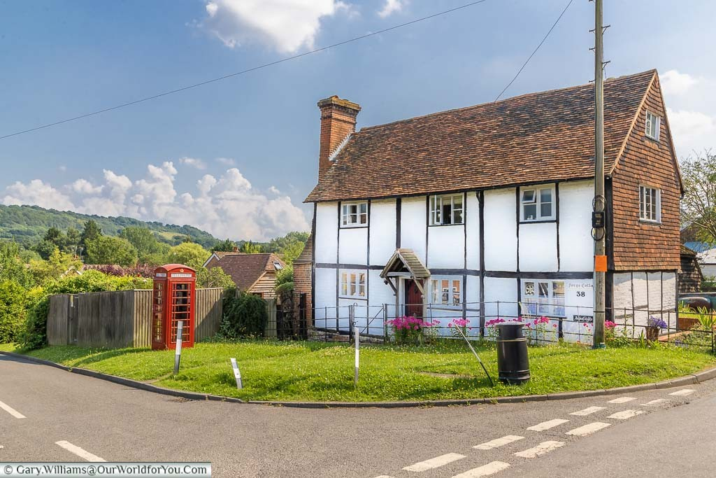 The 16th or 17th-century old forge building at Shoreham, now a home, with a red telephone box in the garden over looking the Darenth Valley