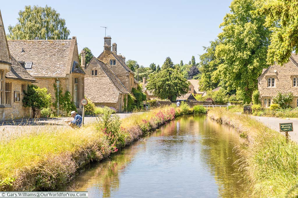 The River Eye flowing through the centre of Lower Slaughter in the Cotswolds