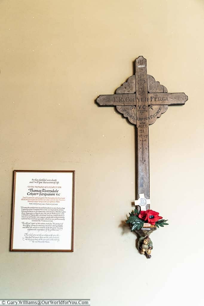 A wooden cross and a certificate in memory of Riversdale Colyer-Fergusson, who won the Victoria Cross in the First World War, mounted in the New Chapel of Ightham Mote