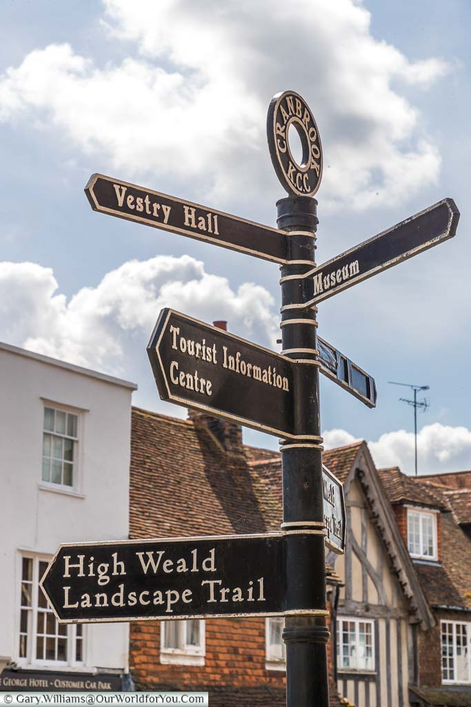 A street sign pointing out all the places of interest in Cranbrook including the museum, vestry Hall and the tourist Information Centre.