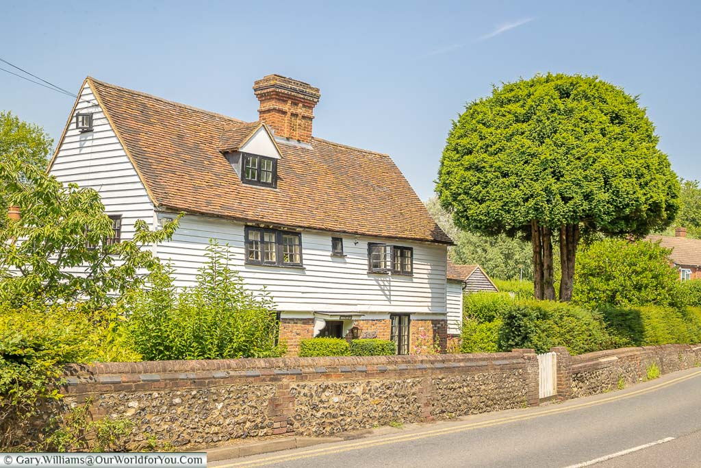 The white weatherboarded 17th century Willow Cottage on Station Road, Eynsford