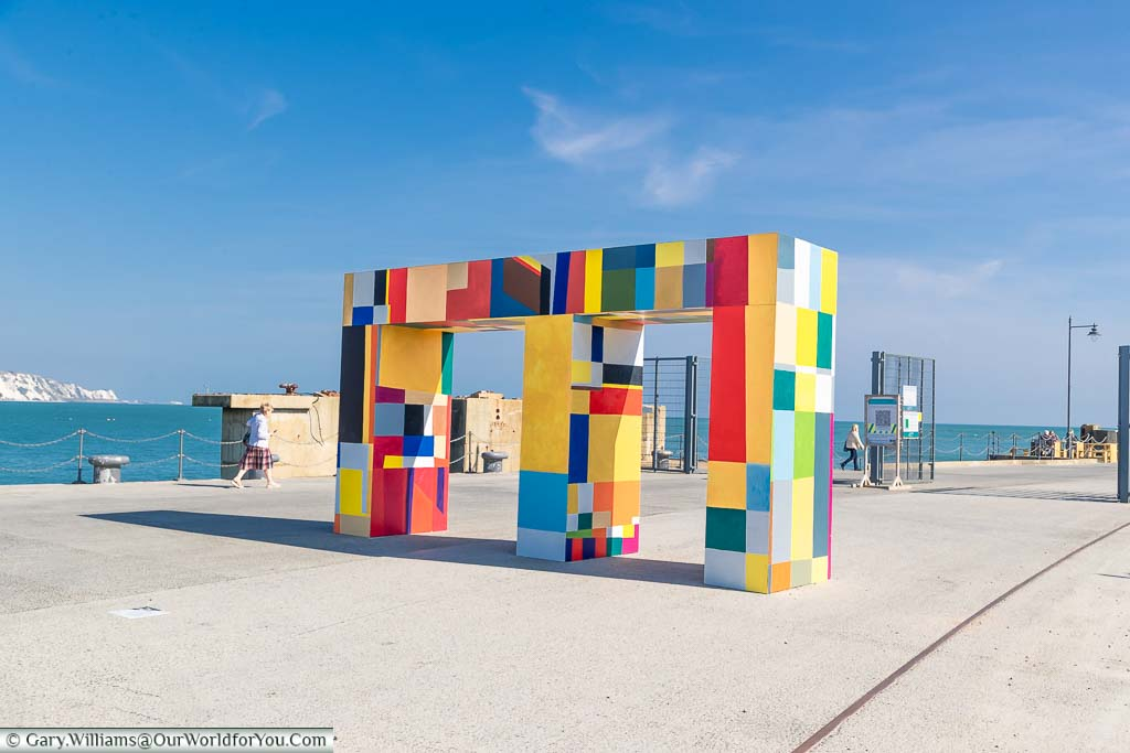 A brightly coloured gateway on the harbour arm in Folkestone by Atta Kwami