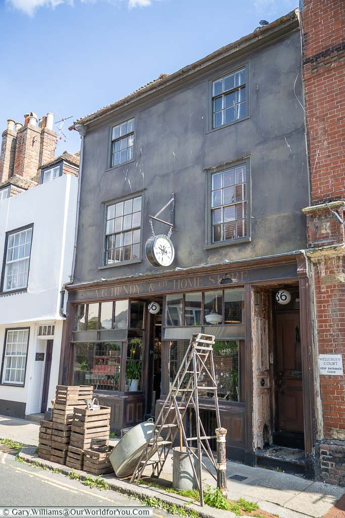 A traditional old hardware store on Hastings High Street with a selection of good on the pavement outside.