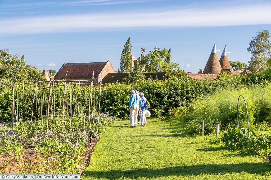 Strolling through the vegetable garden with the Sissinghurst Castle tower in the background