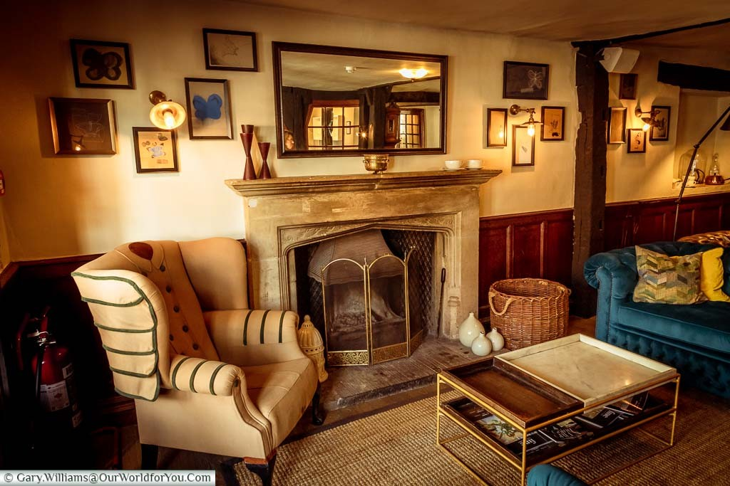 Seating around a large stone fireplace in the lounge area of the White Horse Hotel, Dorking