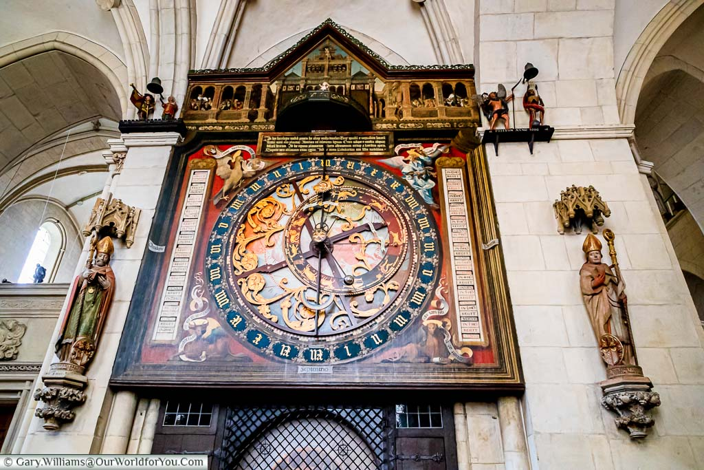 A close-up of the top two-thirds of the Astronomical Clock. The top section contains the automated section with the depiction of the adoration of the magi. The centre section includes the astronomical clock with the time, lunar & planetary phases in a beautiful ornate design.