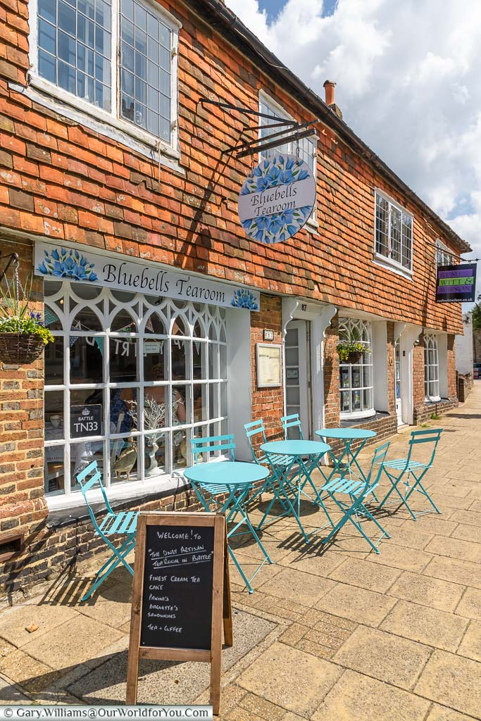 Aqua coloured tables & chairs lined up outside Bluebells Tearoom on the High Street in Battle, East Sussex
