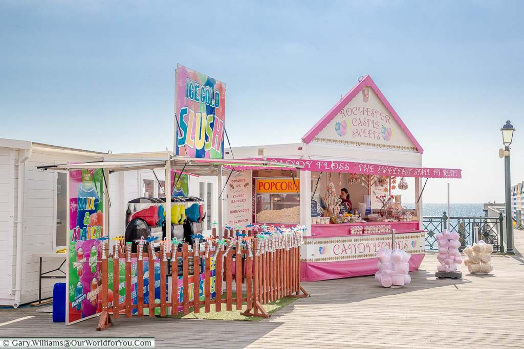 Traditional stall on Hastings Pier selling candyfloss, slush puppies, popcorn & sticks of rock
