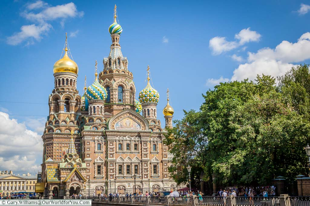 The wonderfully ornate Church of the Saviour on spilled blood alongside the canal banks in Saint Petersburg Russia. It topped by brightly coloured onion domes of various styles.