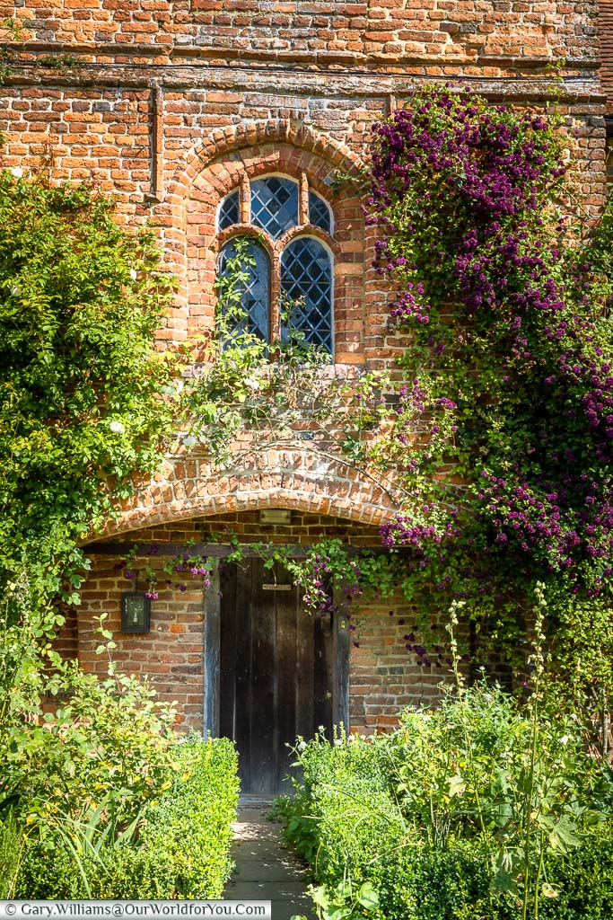 A small door & window in the red-brick front of the manor house of Sissinghurst Castle, Sissinghurst Castle Garden, Kent, England