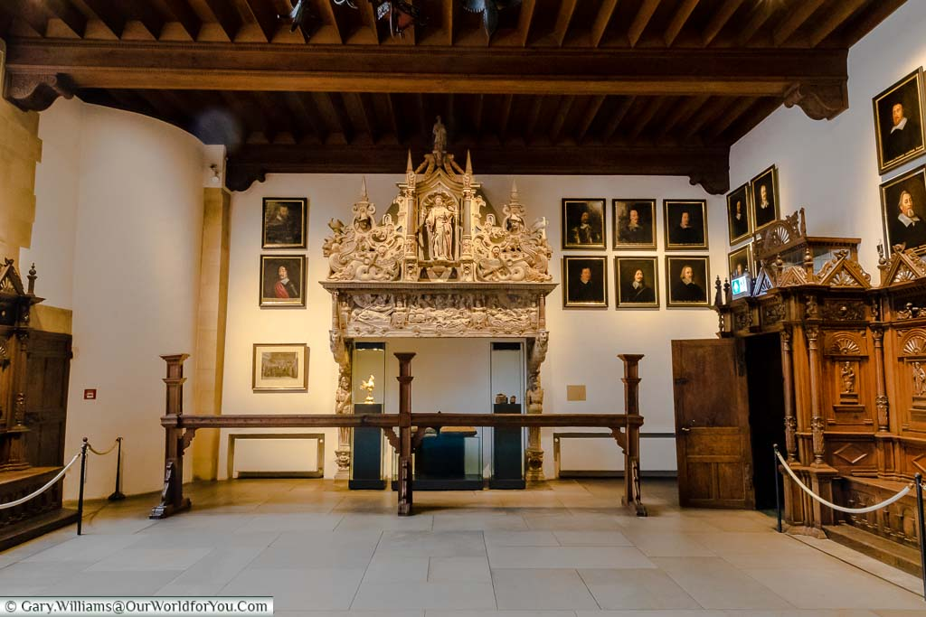 The grand fireplace inside the Hall of Peace, inside the Rathaus of Munster. It stands behind the 'Bar', a wooden beam that separated the general public from the working s of the court.