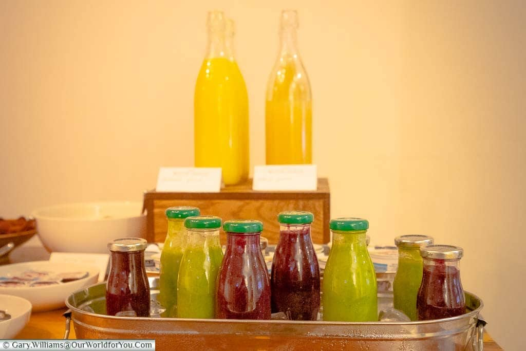 Juices laid out in the breakfast bar of the dining area of the White Horse Hotel in Dorking