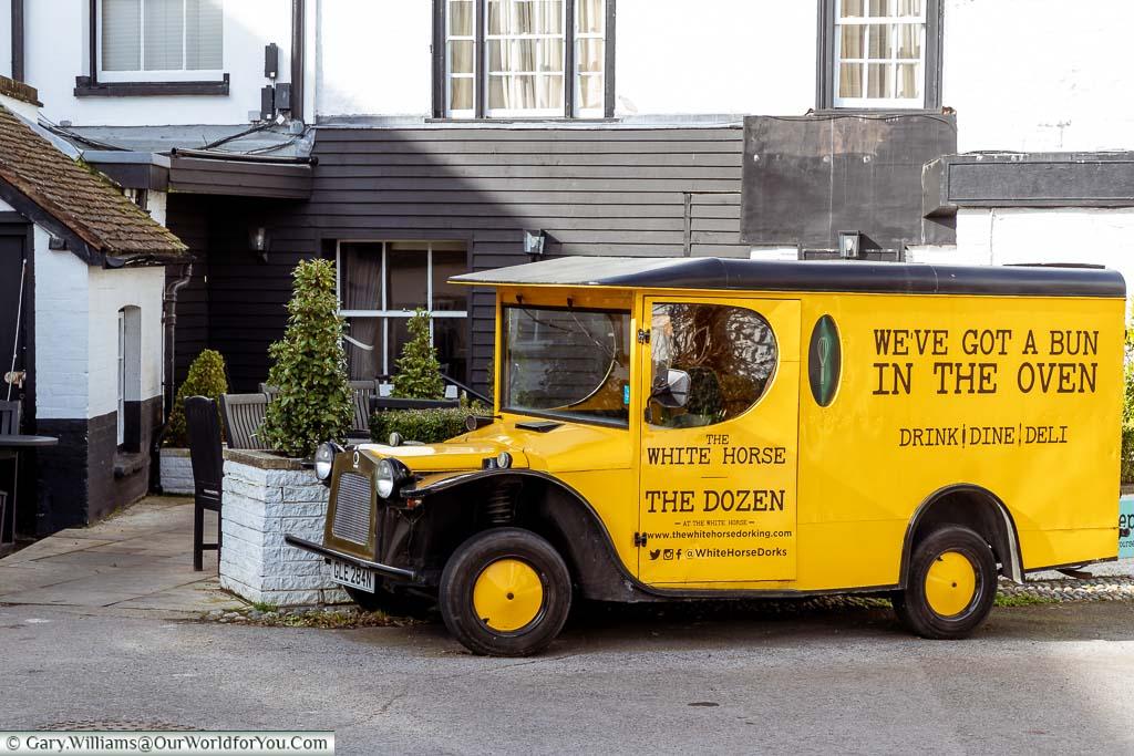 A bright yellow replica period delivery van for The White Horse & The Dozen in Dorking