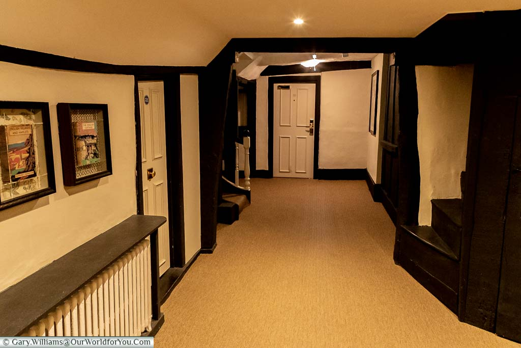 The Tudor interior of the first floor corridors of White Horse Hotel in Dorking