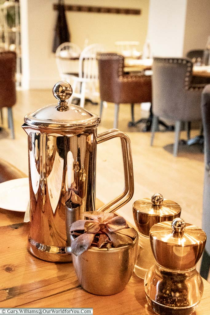 A highly polished cafetière on our table in the restaurant of the bespoke White Horse Hotel in Dorking