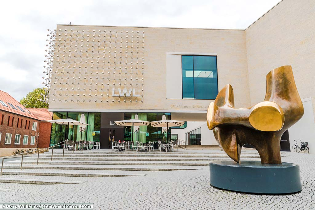 A brass art installation in front of the LWL - Museum for Art and Culture. The modern styled art gallery and museum is just a few minutes walk from the cathedral in this compact historical city.