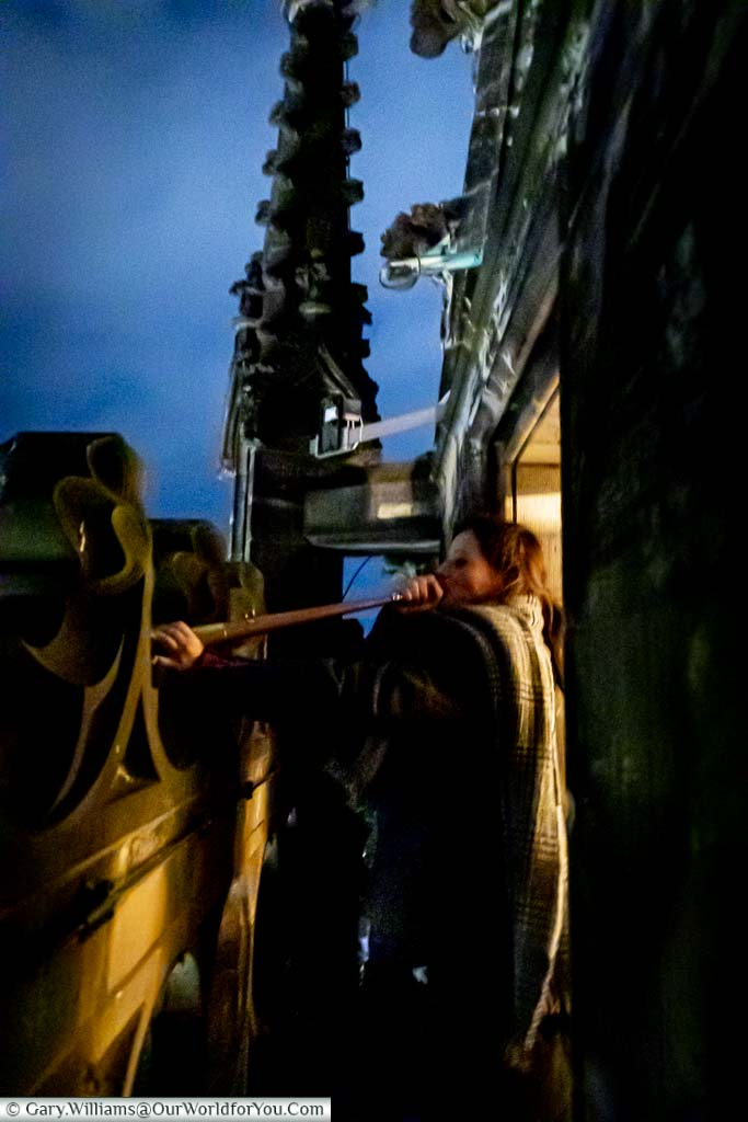 Martje Salje, the Tower Keeper, blasting her horn at to sound the all-clear from the top of the spire of St. Lamberti Church.