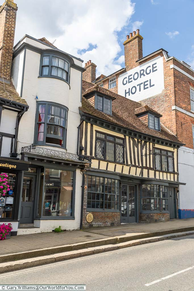 Historic shops squeezed into gaps on Battle High Street, East Sussex