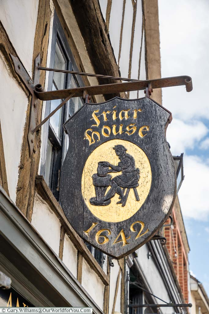 The hand-painted traditional sign for The Friar House, established in 1642 on Battle High Street, East Sussex
