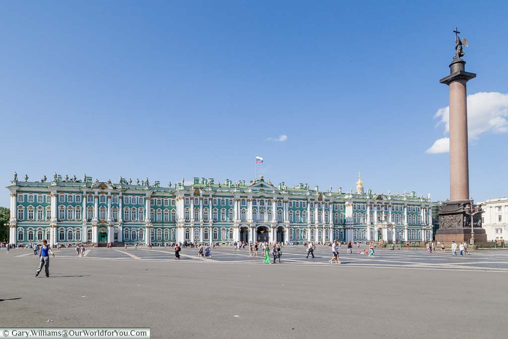 The green and white exterior of the Hermitage Museum Palace Square with the Hermitage Museum, or Winter Palace, from across Palace Square in Saint Petersburg, Russia