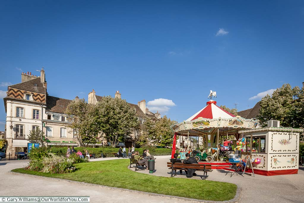 A traditional carousel in the peaceful Place Carnot in the centre of Beaune, in the heart of the burgundy wine region of France