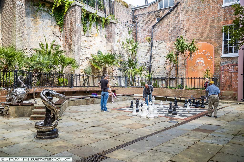 A game of giant-sized chess being played on Geroge Street