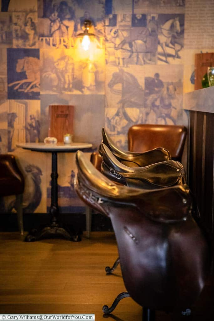 Saddles provide the seating at the 'Pickwick Papers' themed Dozen Bar of the White Horse Hotel in Dorking