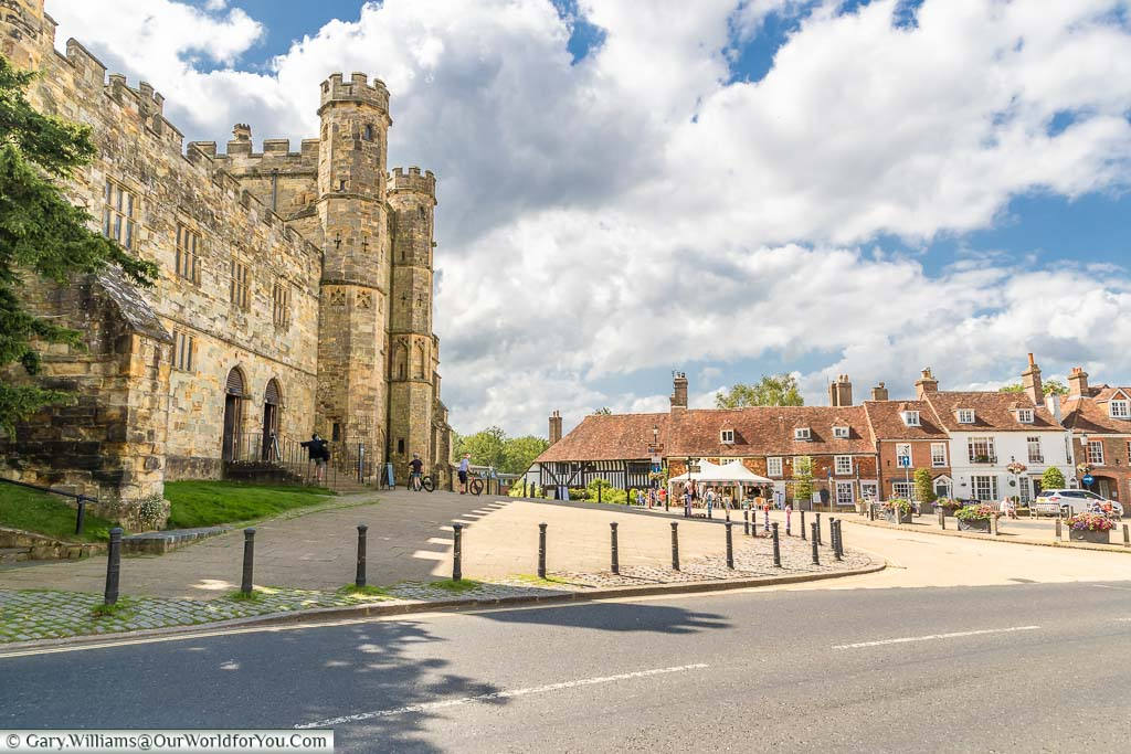 The Abbey Gatehouse and Abbey Green, lined at the edge with red-tiled medieval buildings in Battle, East Sussex
