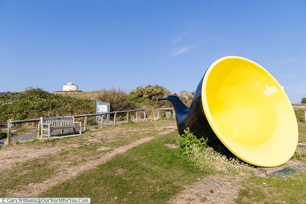 The Siren art installation on the cliffs overlooking Folkestone that looks like a giant, yellow-lined, blue ear trumpet.
