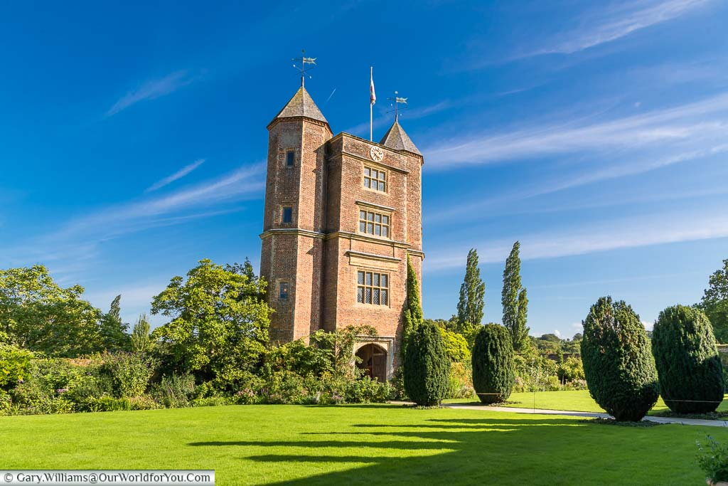 The green lawn in front of the Sissinghurst Castle's turreted tower at Sissinghurst Castle Garden