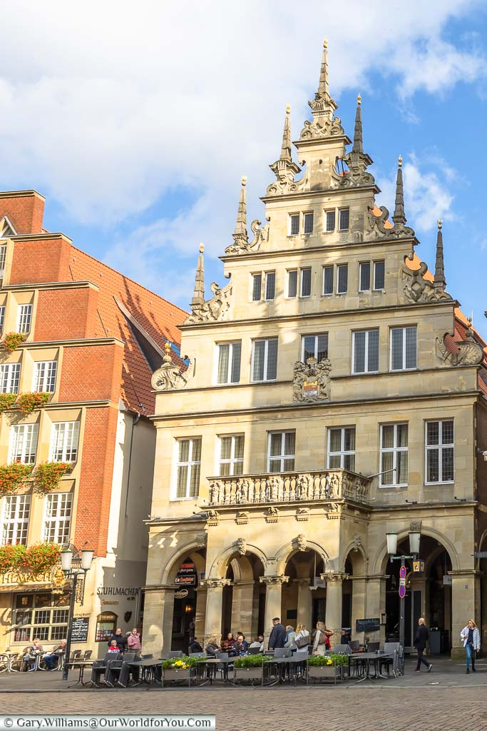 The outside of the Stadtweinhaus, or Town Wine house, built next to the Rathaus, or town hall. In keeping with the other buildings on Prinzipalmarkt the, 17th-century, gable-ended building is constructed of local sandstone. It has a first-floor balcony historically used issuing public notices.