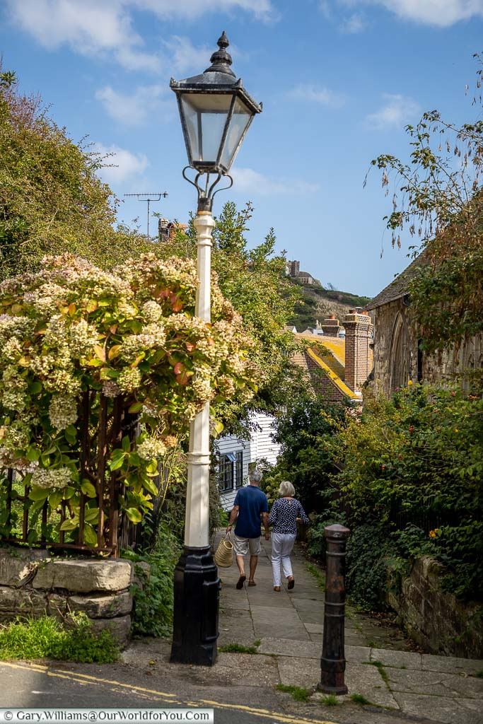 An old cast iron lamp post at the top of the picturesque Church Passage in Hastings