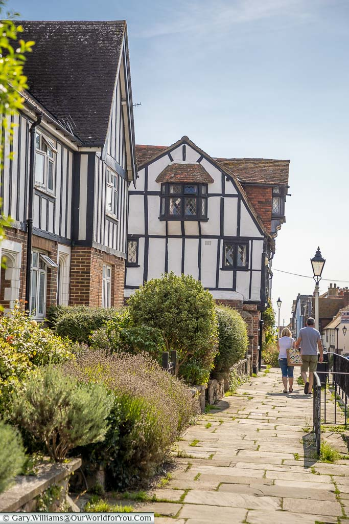 A couple strolling along All Saints' Street in Hastings