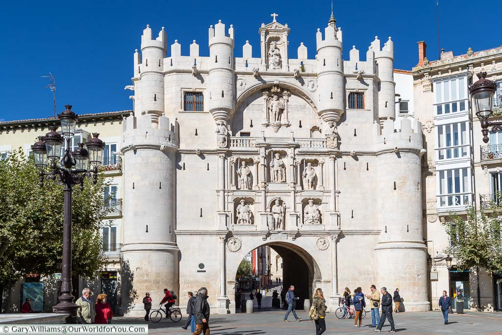 The ornate medieval gate leading into the cathedral square in Burgos, Spain