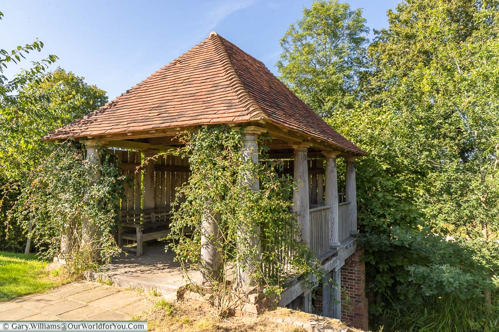 The boathouse with its red-tiled roof at Sissinghurst Castle Garden