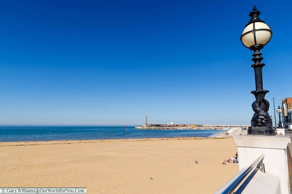 The view from the Margate's Promenade, featuring it's ornate Victorian street lamps, looking over the golden sands of Margate's main beach.