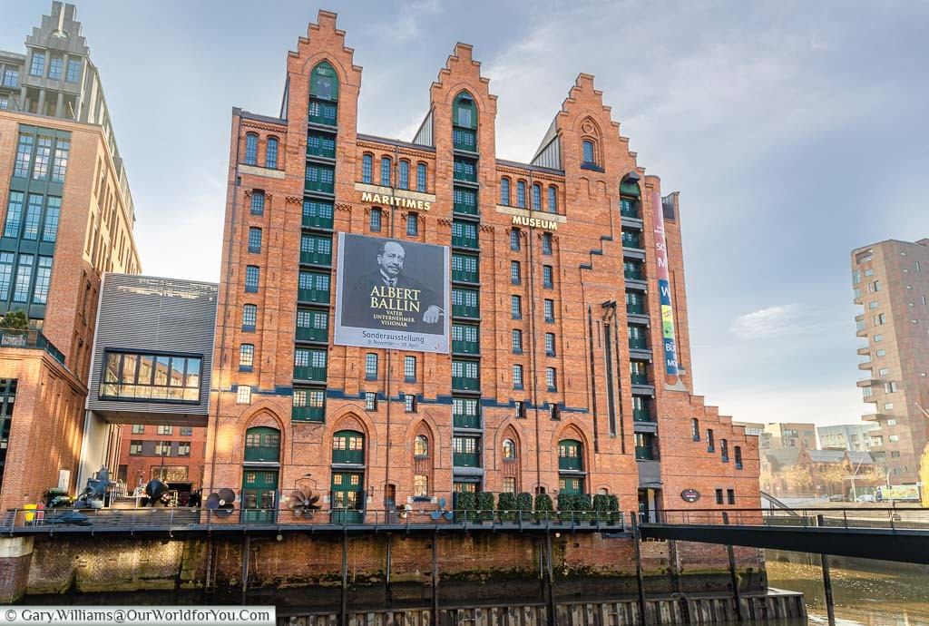 A tall red brick building typical of the Speicherstadt district in Hamburg but now how houses the Maritime Museum.