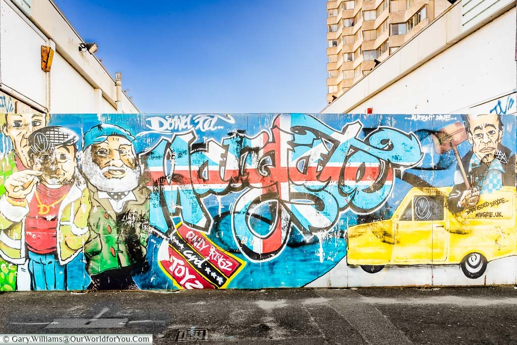 The street mural to the Only Fools & Horses 'Jolly Boys' Outing' episode on some hoardings on the seafront of Margate
