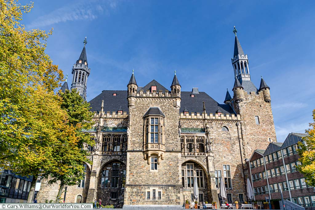 The back of the Rathaus on a bright day, with blue skies. The gothic building is another place that should be on your to-do list when visiting.