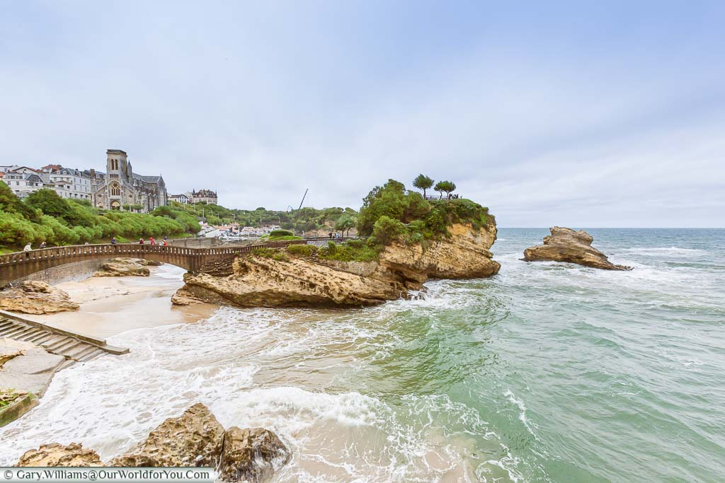 A pedestrian bridge leading to a viewpoint on the rocks in the bay of Biarritz, France