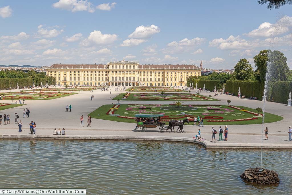 The view of the Schönbrunn Palace and its gardens from Neptune's Fountain on the hill.
