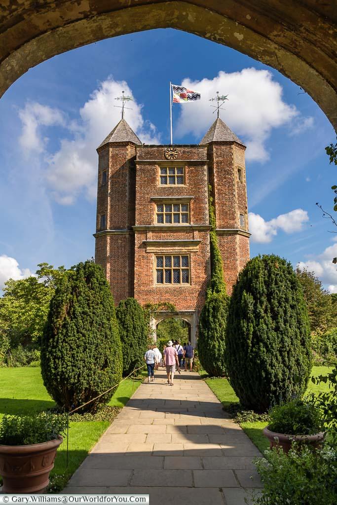 A look through the entrance arch to the Sissinghurst Castle Tower, Sissinghurst Castle Garden, Kent, England