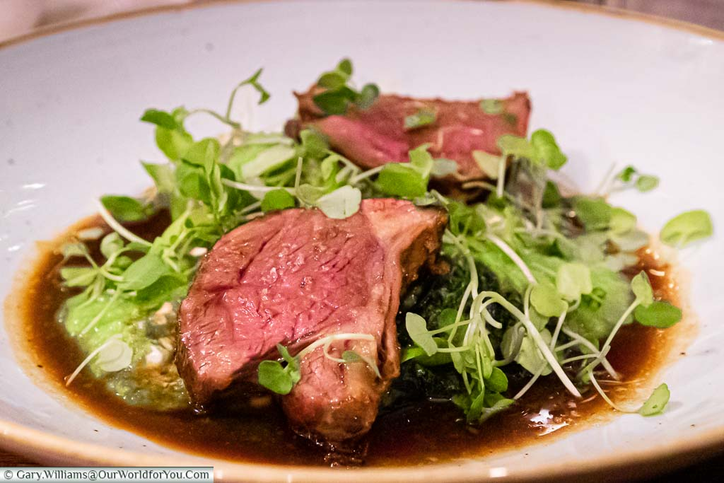 Janis's main course of harissa spiced lamb rump served with grilled baby gem lettuce and tzatziki