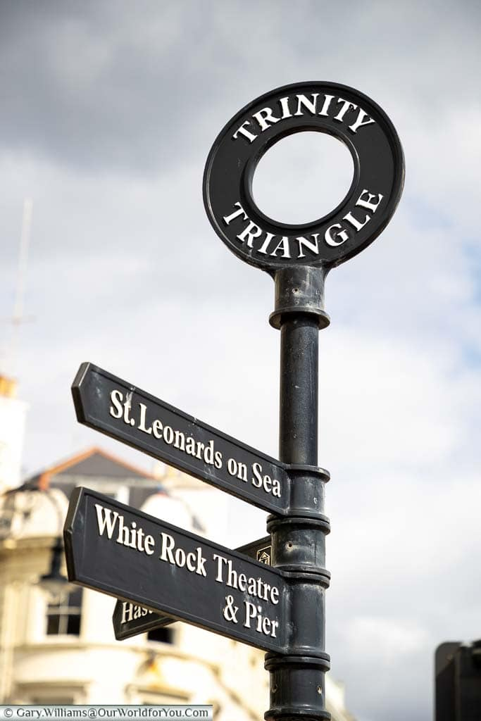 A traditional cast iron street sign for the Trinity Triangle district of Hastings