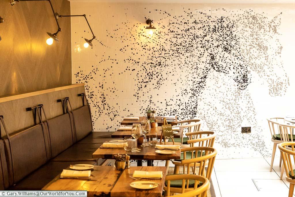 Two white horses on a mural inside the Dozen Restaurant of the White Horse hotel in Dorking