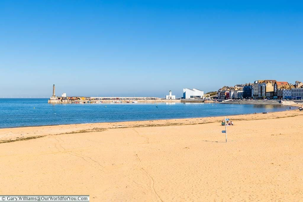 The golden sands of Margate's beach with the Harbour arm leading to the Turner contemporary gallery in the distance.